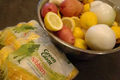 Getting the small potatoes, corn on the cob, onions and lemons ready to boil