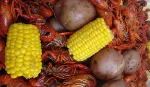 Boiled Texas crawfish, corn on the cob, and potatoes ... let's get peeling!