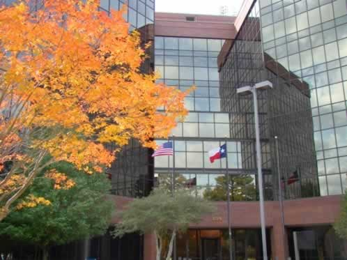 Even in urban areas, fall makes an impressive show in East Texas, as in this photo of an office building  and fall foliage in Tyler on Loop 323